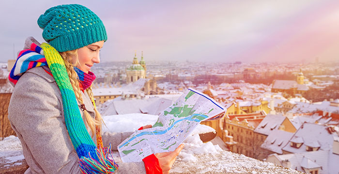female_traveler_with_map_in_winter