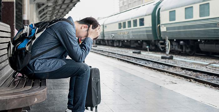 upset_man_at_train_station