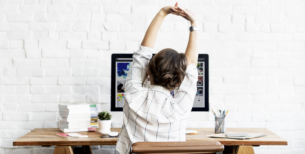 woman_stretching_at_desk