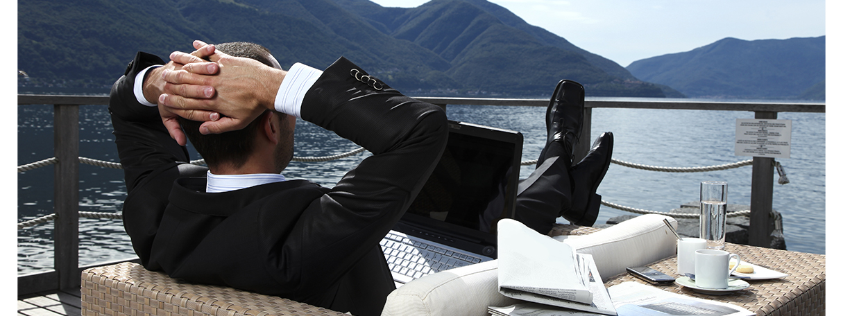 businessman_relaxing_by_lake