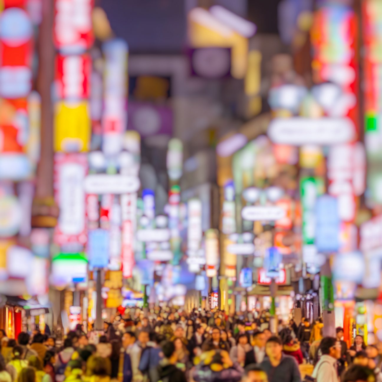 neon signs and crowds in Tokyo