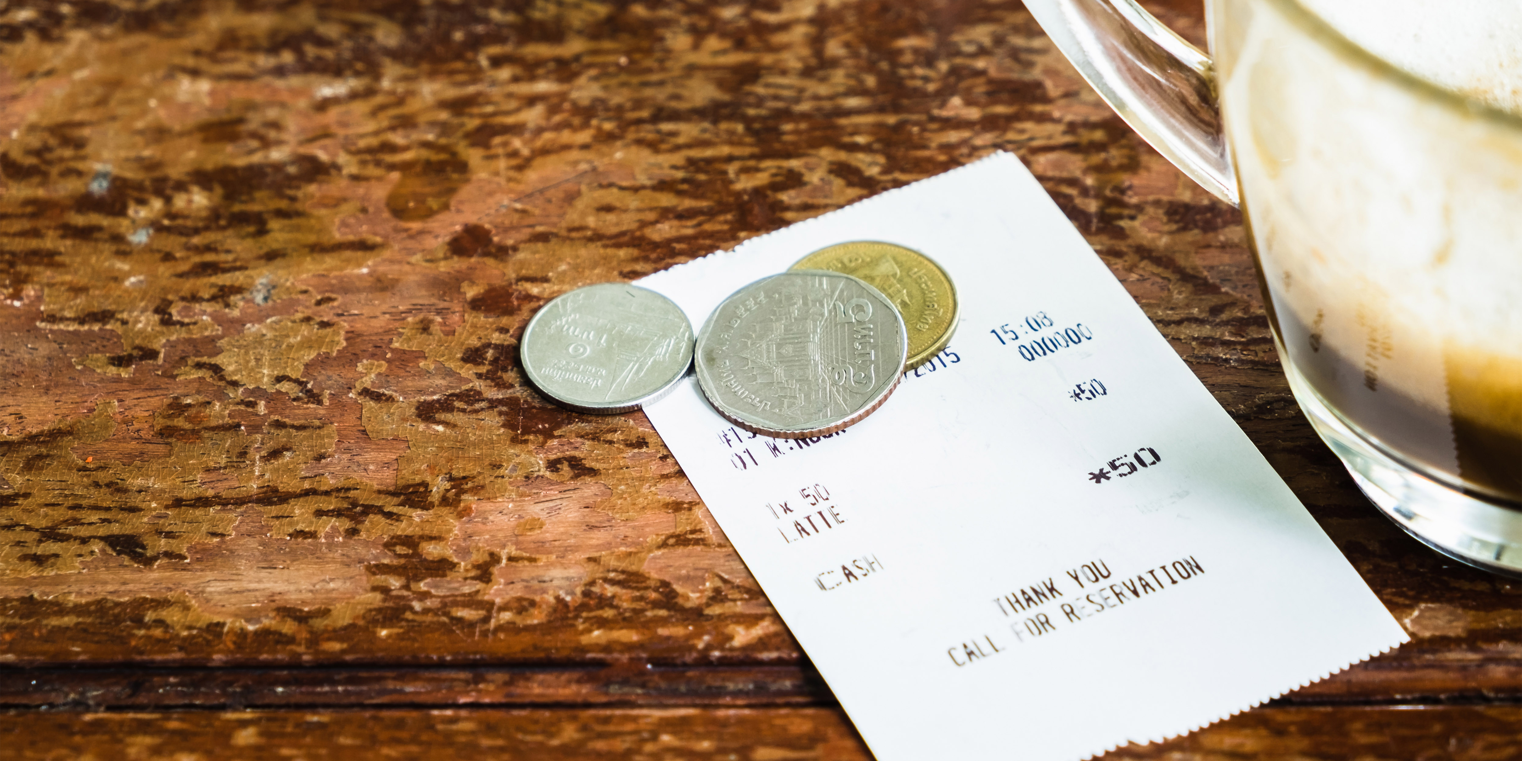 tip on table with receipt and beer