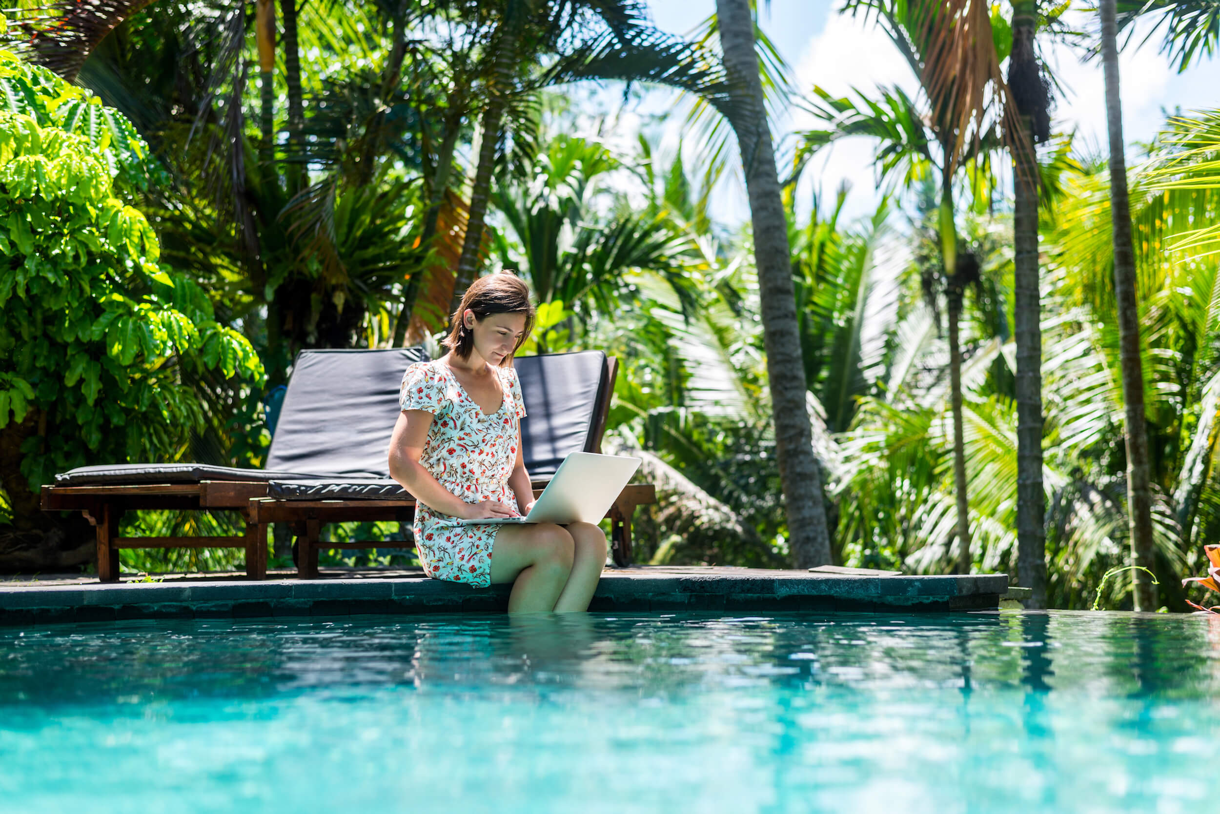 Girl working remotely at pool