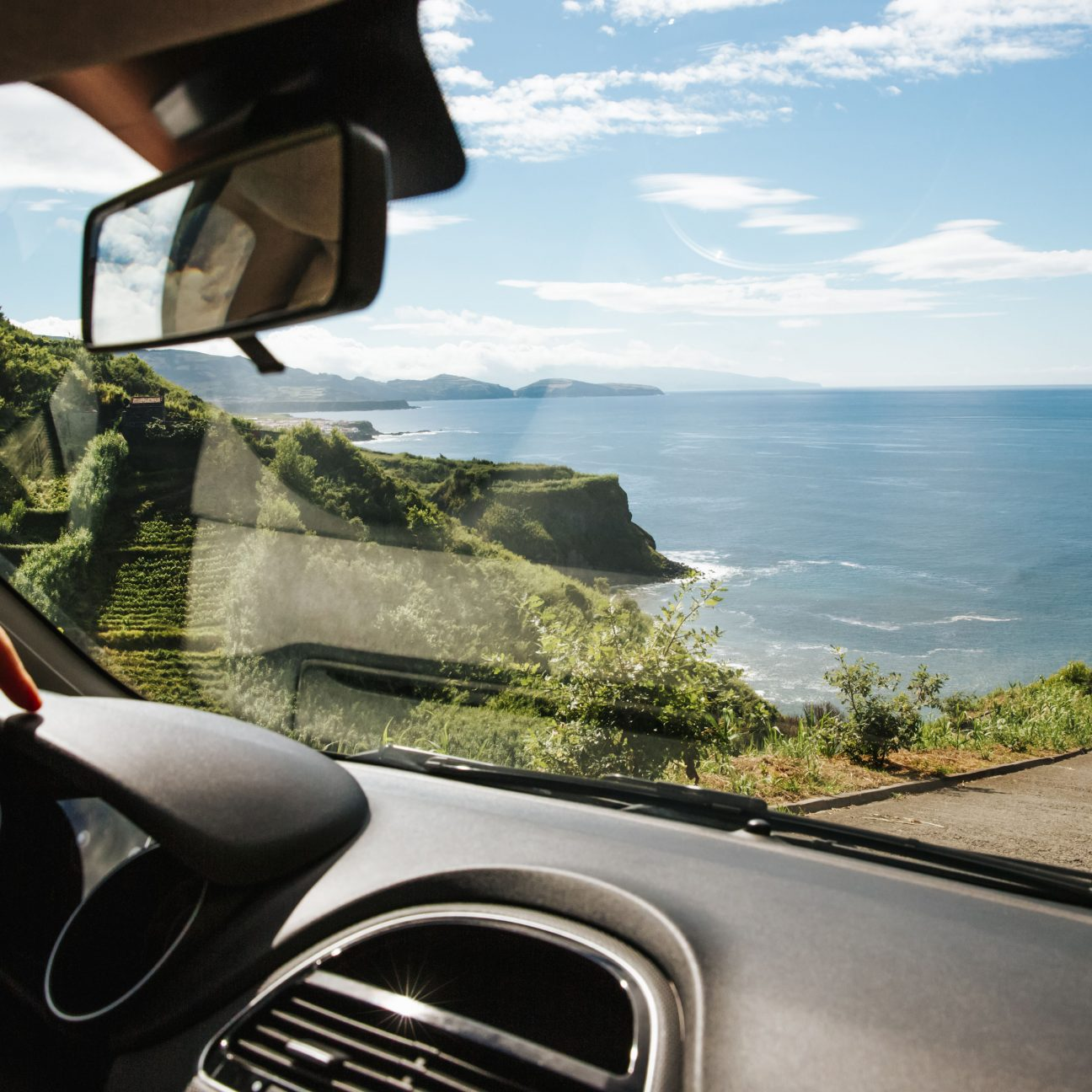 car with a view of the ocean