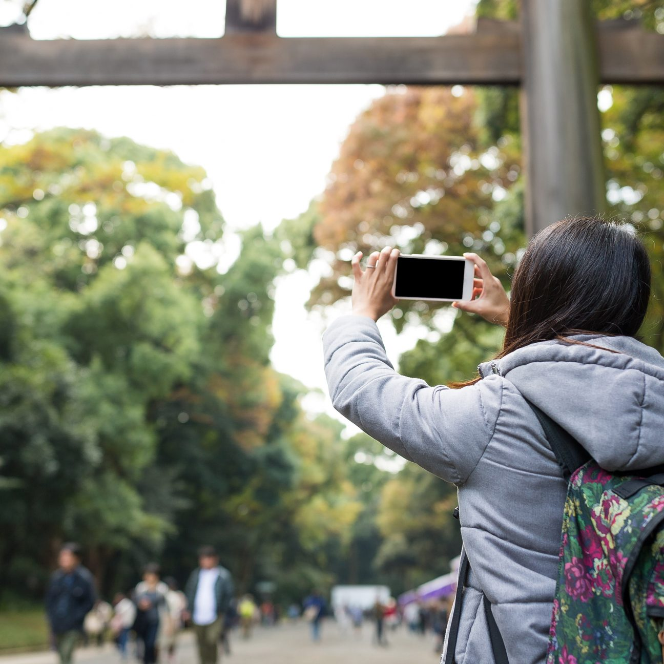 girl with backpack taking Instagram in Tokyo