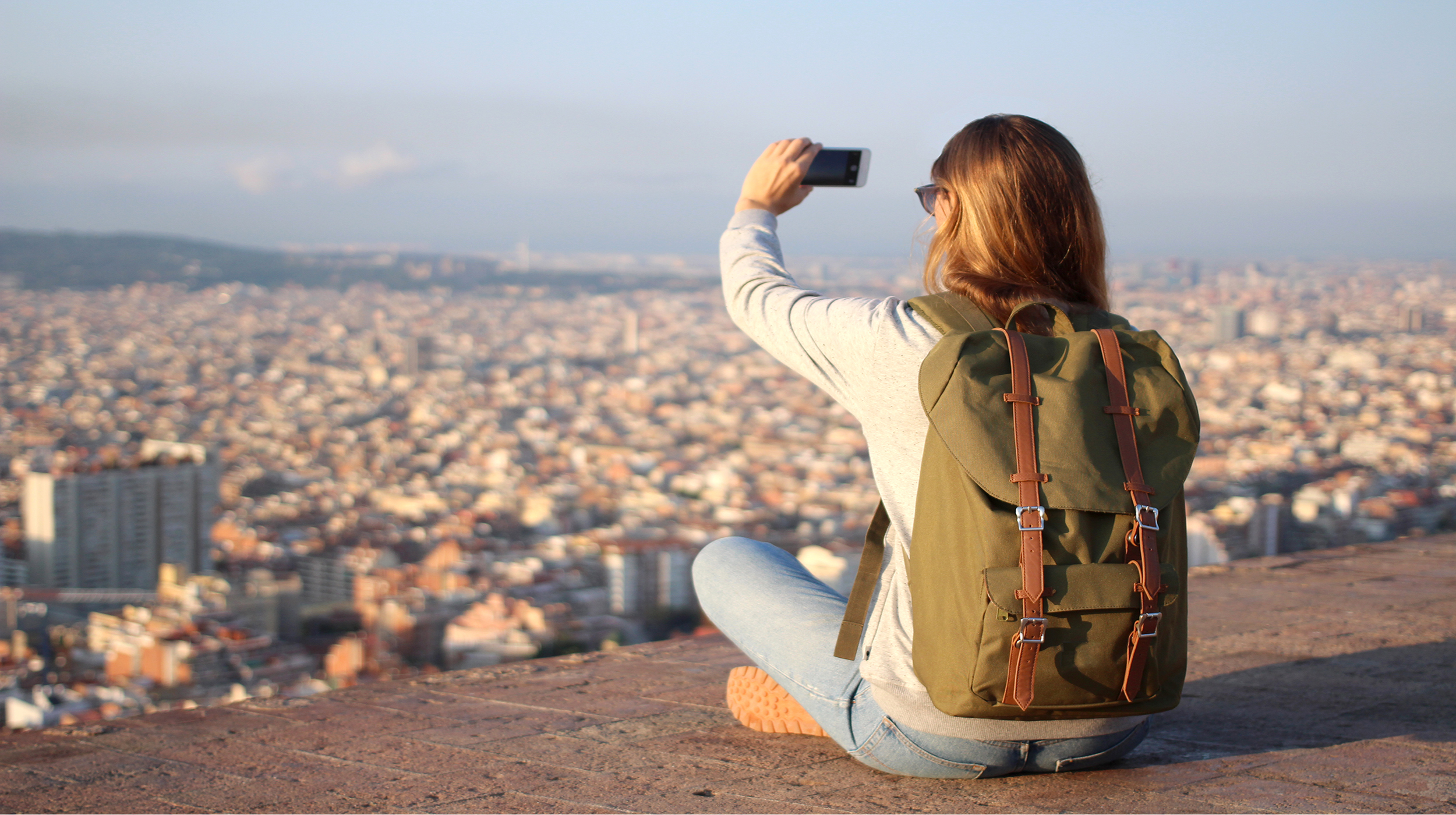 Girl taking picture in Barcelona