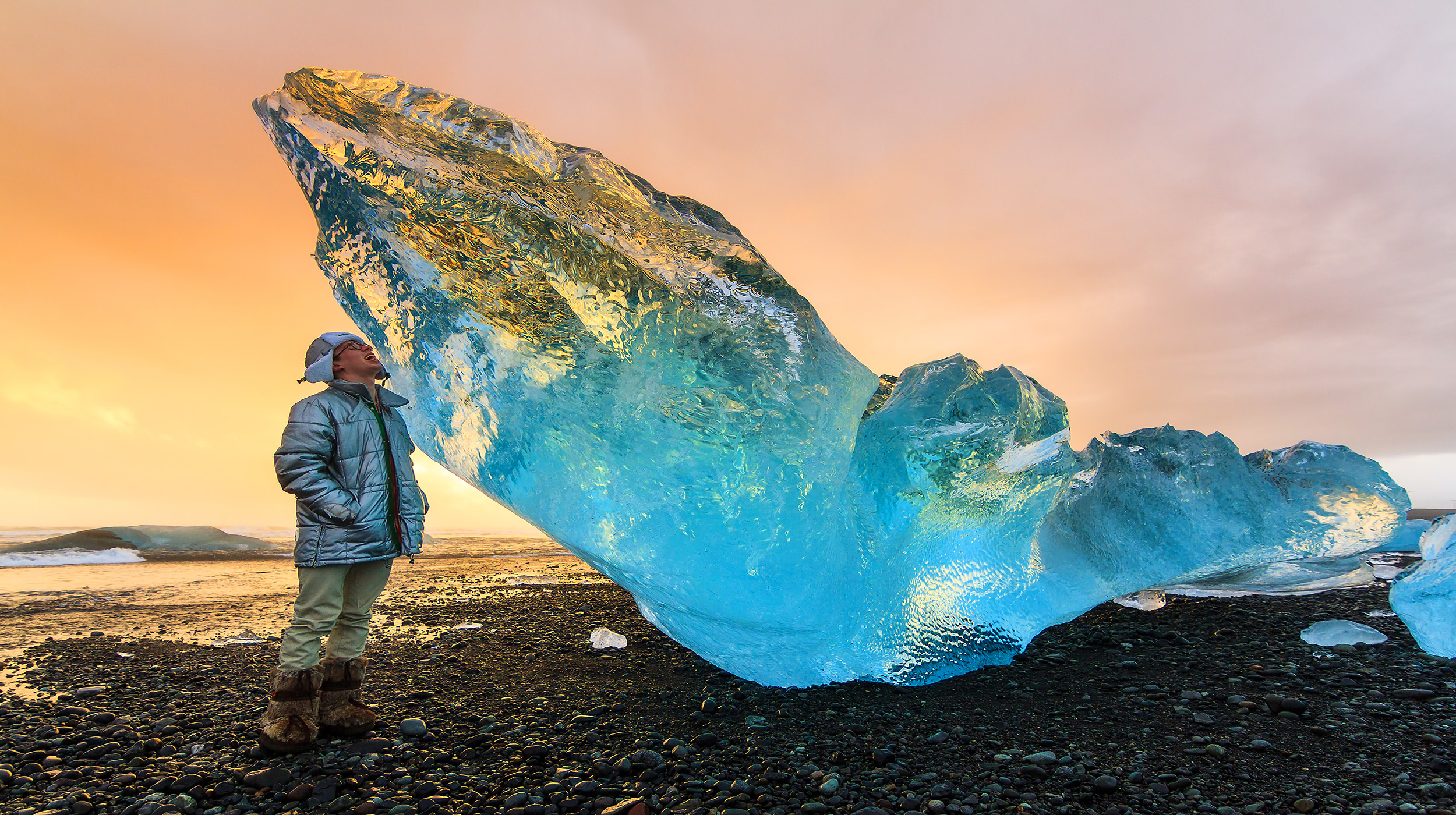 person next to ice in Iceland