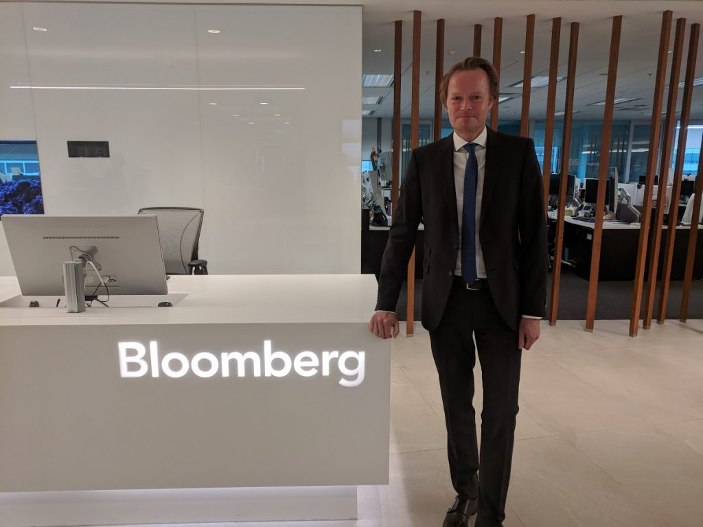 Svend Janssen posing by Bloomberg desk