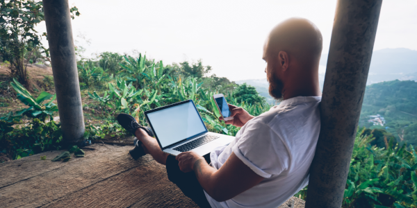 Man working on his laptop in the nature