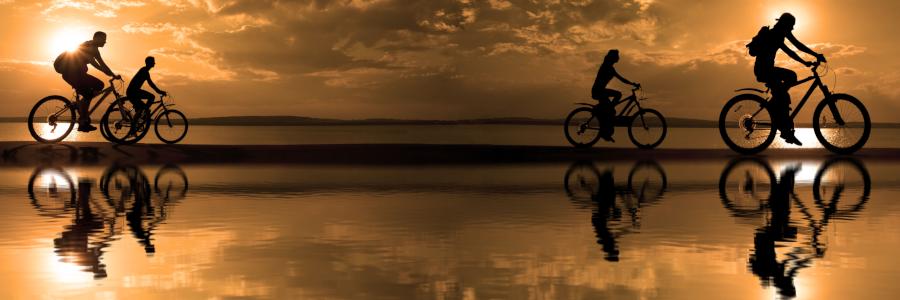 Group riding bike on a beach