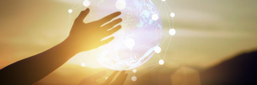 hand transforming glowing globe