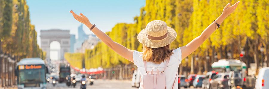 Female College Student Explores Champs-Elysses in Paris