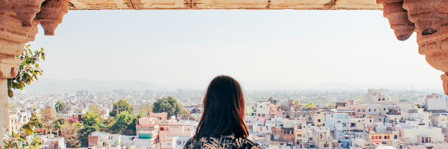 Woman looking out over city